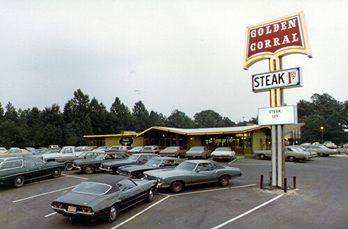 A parking lot of an old Golden Corral from the 1960s